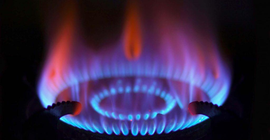 Closeup of gas stove burner in darkness