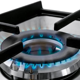 Lit gas stove burner
